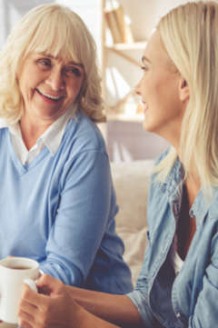 older woman having a conversation with her daughter