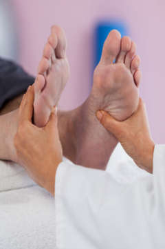reflexology on a man's foot
