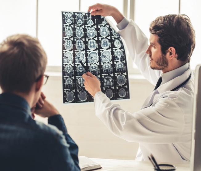 doctor showing patient brain scan