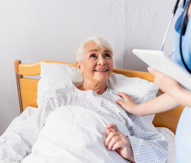 smiling elderly woman in bed