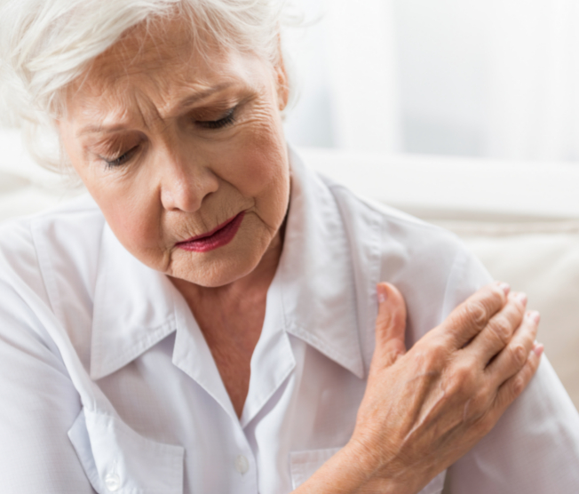 older woman with joint pain