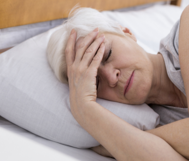 woman with trouble sleeping